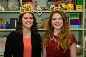 two young women wearing buffalo wild wings crowns