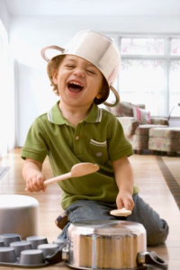 kid yelling with pots/wooden utensils
