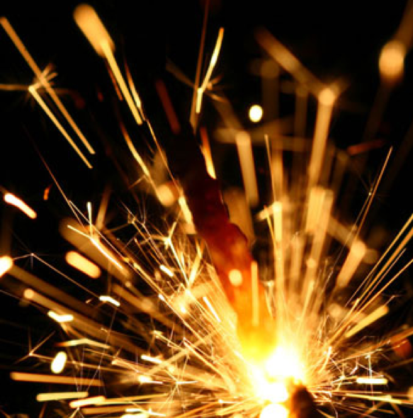 An image a sparkler going off.