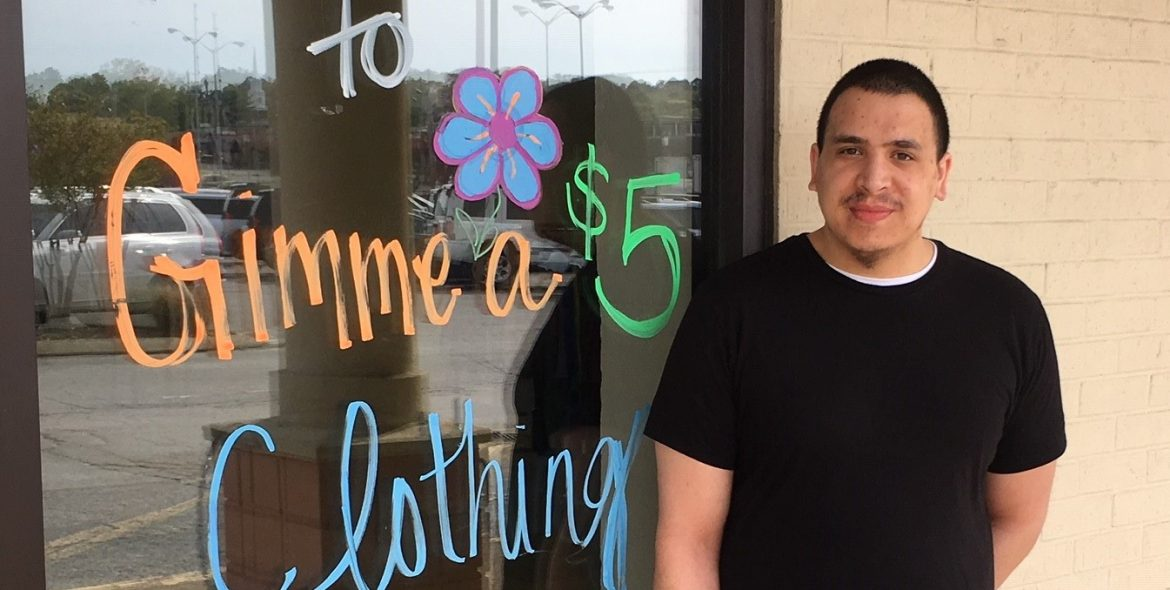STAR Center clients smiles in front of his new place of employment.
