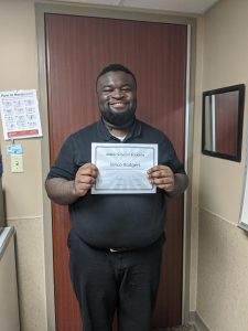 Young African American male receiving the Project Search Award Intern of the Rotation
